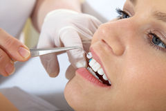 Woman at the dentist visit Stock Photo