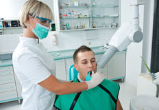 Woman dentist at work Stock Image