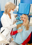 Woman dentist at work Royalty Free Stock Images