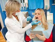 Woman dentist at work. With patient Royalty Free Stock Photography