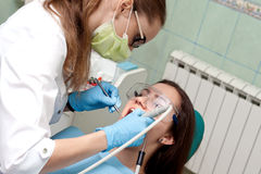 Woman dentist at work with patient Royalty Free Stock Photography