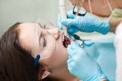 Woman dentist at work with patient Stock Photos