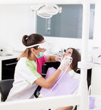 Woman dentist working with the driller Royalty Free Stock Photo