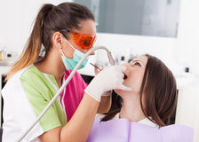 Woman dentist working with the driller Stock Photography