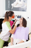 Woman dentist working with the driller Royalty Free Stock Photography