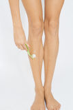 Woman depilate her legs. Beautiful young woman depilate her legs Stock Image