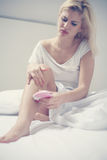 Woman depilate her legs. Close up portrait of woman depilation Stock Images