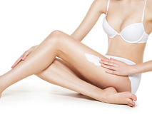 Woman depilating legs by waxing Royalty Free Stock Photos
