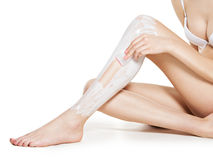 Woman depilating legs by waxing Stock Photos