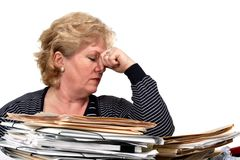 Woman depressed by work pile Royalty Free Stock Photo