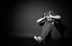 Woman in depression and despair crying,  clutching his hands beh Stock Photos