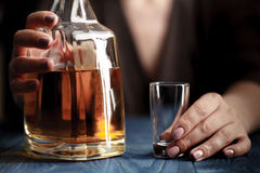 Woman in depression, drinking alcohol on dark background Stock Photography