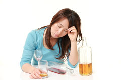 Woman in depression is drinking alcohol Stock Photo
