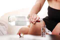 Woman in depression, drinking alcohol (vodka) Royalty Free Stock Photo