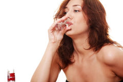 Woman in depression, drinking alcohol (vodka) Stock Photos
