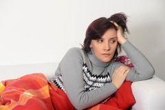 Woman in depression sitting on the couch Stock Photo