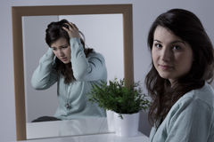 Woman with depression. Young woman with depression hiding her emotions Stock Photo