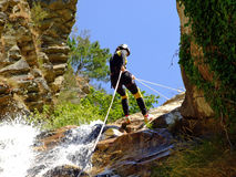 Woman descending on rappel Royalty Free Stock Image