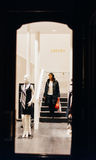 Woman descending stairs of luxury fashion store Escada. STRASBOURG, FRANCE - DEC 20, 2016: Woman descending stairs of an Escada store with shopping bags full Stock Photos