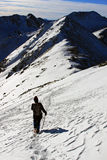 Woman descending from the top of the mountain in Retezat mountains, Romania Stock Photo