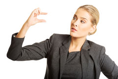 Woman describes a size with her fingers Royalty Free Stock Photography