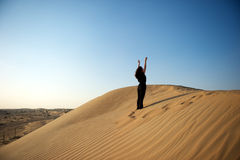 Woman in the desert Royalty Free Stock Photos