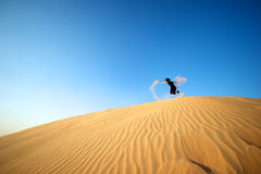 Woman in the desert stock image