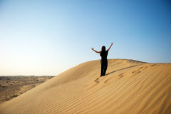 Woman in the desert Royalty Free Stock Photo