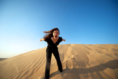 Woman in the desert Stock Photo