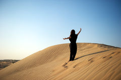 Woman in the desert Royalty Free Stock Image