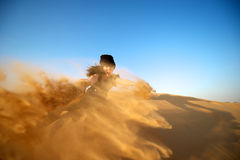 Woman in the desert Stock Images