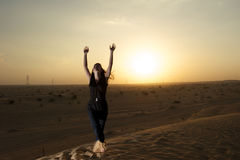 Woman in the desert Stock Photos