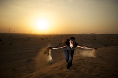 Woman in the desert Stock Photography