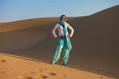 Woman in desert. Young woman posing in desert dunes in India Royalty Free Stock Photos