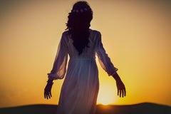 Woman on desert tour looking into sunset Royalty Free Stock Photography