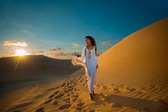 Woman on desert tour in sunset in Vietnam Royalty Free Stock Images