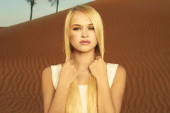 Woman and desert. UAE Royalty Free Stock Photos