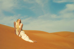Woman and desert. UAE Royalty Free Stock Photography