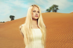 Woman and desert. UAE Stock Images