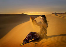 Woman in desert. Young woman in the desert in Dubai Royalty Free Stock Photo
