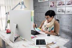 Woman designer chooses color palette Stock Photo