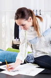 Woman designer drawing a project Stock Photo