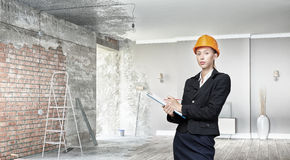 Woman designer in interior Royalty Free Stock Image