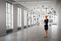 Woman designer in interior Stock Photography