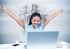 Woman at Desk with hands in air against sketch of buildings and blurry grey wood panel Royalty Free Stock Images