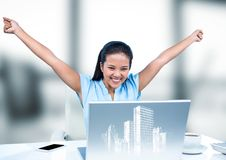 Woman at desk with hands in air behind white graphic of buildings and against blurry grey window Stock Photography