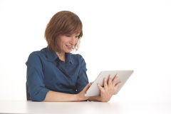 Woman at desk with I pad. Young business woman at desk with I pad Royalty Free Stock Photography