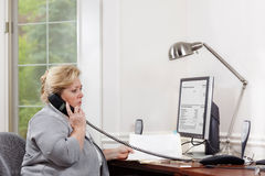 Woman desk phone conversation Royalty Free Stock Images