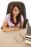 Woman at a desk with a stack of books top angle Stock Photos