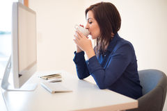 Woman on desk Stock Images